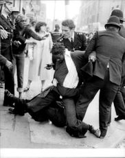The police intervene during the riot in Brixton.
