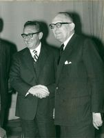 Henry Kissinger shakes hands with France's Foreign Minister Maurice Schumann