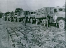 U.S supply trucks refuel during drive on Germany. U.S army supply trucks refuel at a temporary gasoline supply dump somewhere in Holland (1944).