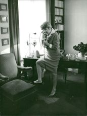 A woman talking on phone.
