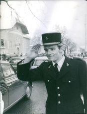 Jean-Claude Killy saluting and smiling.