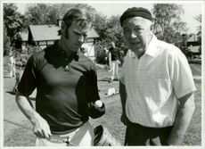 Prince Bertil standing with Sven Tumba in the field while playing golf, 1970.