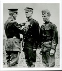 Douglas MacArthur awarded a medal during World War 1 by General John Persin.