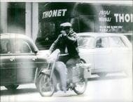 Man riding on motorcycle, on the move.