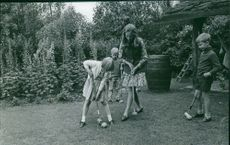 Prince Albert II`s family playing in the garden.