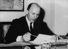 Claude Lebel at his desk, in office.