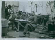 Soldiers siting together in the table during First World War.