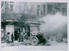 Soldiers firing a canon. Germany, May 1945
