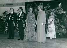 Georges Pompidou with his wife Claude Jacqueline waiting for Prince Charles at a party.  - 1972