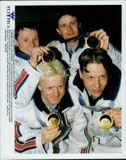 Norwegian skiers Bjarte Engen Vik, Fred Boerre Lundberg, Halldor Skard and Kenneth Braaten with their gold medals during the Winter Olympics 1998