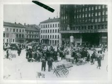 People waiting to buy their fruits and vegetables at market square in Oslo, Norway 1942.