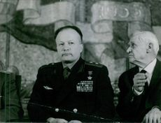 "A general sitting with other men.  ""General __""  1965"