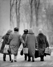Women on their way from the ruins church in Leningrad after receiving food from a Swedish aid mission