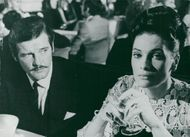 """Roger Moore and Hildegard Neil in """"The Man Who Chased Himself""""."""