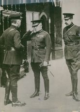 Soldiers standing while saluting to the officer during Tyskland war.