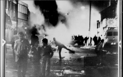 A firebomb puts the street on fire at the riot in Handsworh