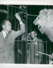 Vice President Nixon in Washington is greeted by Barnums and the lion Sheba in the cage.