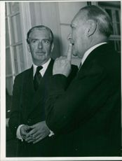 Konrad Hermann Joseph Adenauer talking to a man.