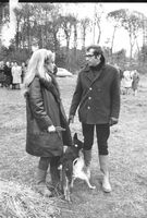 Roger Vadim standing with Jane Fonds and talking to her.