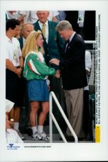 Irish swimmer Michelle Smith, winner of so far 3 gold, greets US President Bill Clinton at the pool during the Olympic Games in Atlanta 1996