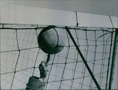 A football being touched to goal by a human finger.