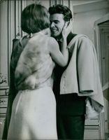 Woman romancing with Horst Buchholz and smiling, 1968.