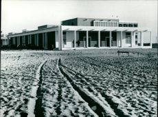 The President's Palace of Mauritania stands surrounded by sand