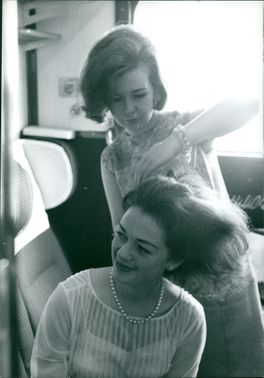Woman grooming another woman.