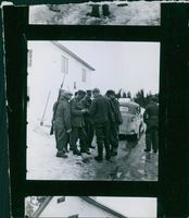 Soldiers gathered outside while having conversation during Winter war.