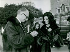 Miss World 1963 contestant Miss France asking for someone's autograph.  - Nov 1963