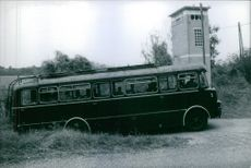 A bus passing through the raw road in the village.