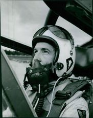 A fighter pilot sitting inside the fighter airplane.