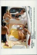 Roger Moore and Kristina Tholstrup board a motorboat together with their children and some friends