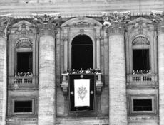 Pope Paul VI standing in the terrace of St. Peter's Basilica in the Vatican City.