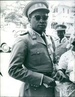 Mobutu standing and looking at the photographer. 1970.