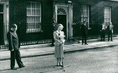 Margaret Thatcher in front of microphones in front of 10 Downing street