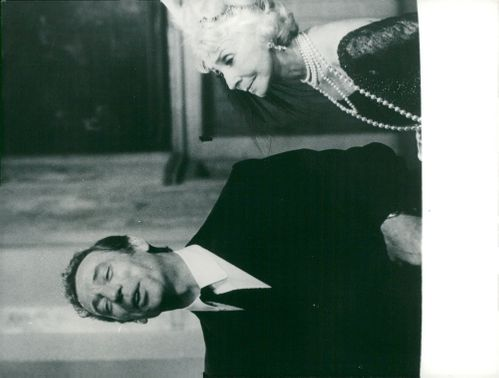 "Yves Montand and Madeleine Renaud in the movie ""Le Diable par la queue"""