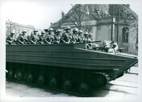 Numerous soldiers on a military tank. tanks