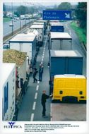 French truck drivers block the A1 highway near Lille