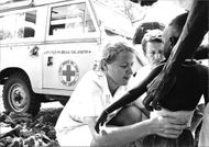 Red Cross doctors and healthcare professionals care for a child in Ethiopia.