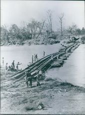 A Colonial troops making a Pontoon bridge during a war.