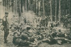 Soldiers cooking while resting in the forest during First World War.