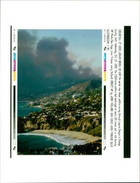 an aerial view shows wildfire.