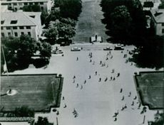 A high angle view of road, people walking.