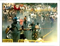 Police use water cannons and Tear gas.