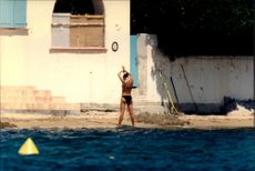 """Crown Princess Victoria on the beach at Princess Lilian's house """"La Mirage"""" on the French Riviera"""