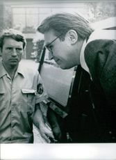 Guennadi Batachev photographed getting out of the vehicle. 1983.