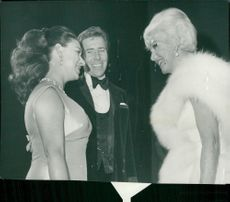 Princess Margaret with husband Lord Snowdon in conversation with Ginger Rogers