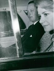 John George Vanderbilt Henry Spencer-Churchill, 11th Duke of Marlborough, and Athina Onassis inside the vehicle. 1961.