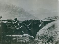 Soldiers hiding in the bunker while pointing a gun during Tyskland War.